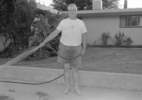 Untitled (man watering lawn)
