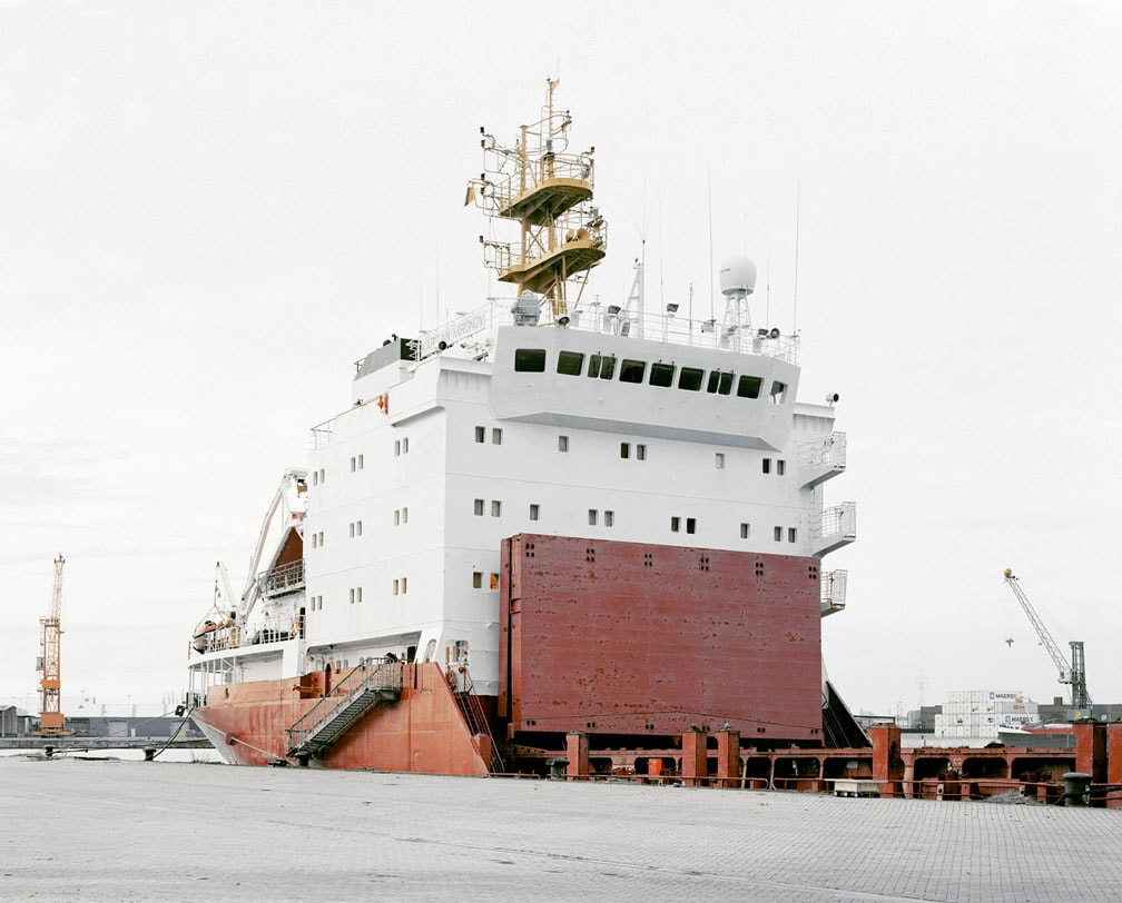 Large white and red transport ship