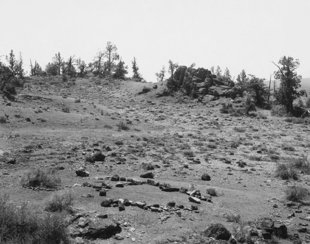 Mark Ruwedel, Pictures of Hell, Barren forest clearing with circle of stones in foreground